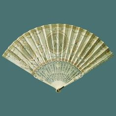 The Power of Love fan c.1780. Leather (kid) leaf; carved and pierced ivory guards (identical) with tortoiseshell inserts at base; carved and pierced ivory sticks (2 + 18). Guard length 27.5 cm. Purchased by Queen Mary, July 1916