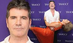 Simon Cowell ditches the serious stare for a smile at Yahoo event