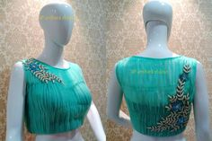 Light blue designer net blouse with patch work on the back and shoulder