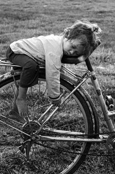Black and white photography / children / bicycles where else would you sleep? that must have been a really long ride ! whimsical, sweet and very cute sleeping child real wonderful life photo