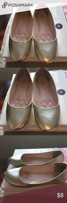 Gold size 10 flats Jazz up any outfit with these gold flats! They are not wide shoes but I've likely stretched them a little but because I have wide feet. Still have plenty of miles left on them. Make me an offer! Size 10! Shoes Flats & Loafers
