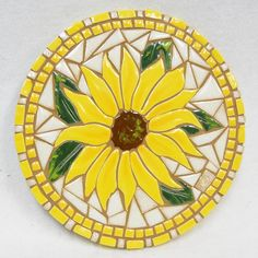 Sunflower Original Mosaic Art Size: 9 diameter x 1 thick Weight: 3 lbs House of Whispering Firs is proud to offer this original mosaic titled Sunflower by Kathy Thompson, Newberg, Oregon. artist. Kathys mosaics are not only beautifully designed and crafted; but, unusual in the Mosaic Garden Art, Mosaic Flower Pots, Ceramic Mosaic Tile, Mosaic Wall, Mosaic Glass, Mosaic Crafts, Mosaic Projects, Stained Glass Projects, Mosaic Designs