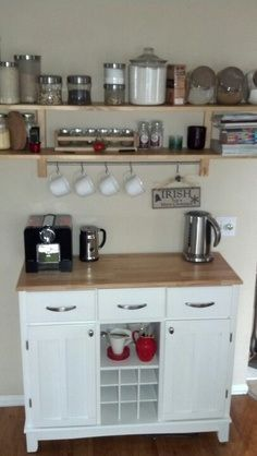 coffee bar. Maybe something like this. Only MUCH more mug storage. MUCH MUCH MORE.