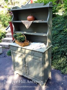 Rustic painted hutch~sage green with black undertones.