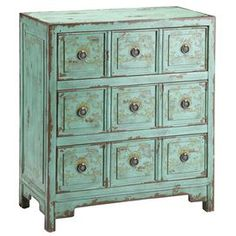 """Hand-painted chest with three drawers and faux apothecary-style facings.    Product: ChestConstruction Material: WoodColor: Vintage greenFeatures:   Apothecary styleHand-paintedThree drawers Dimensions: 31"""" H x 27"""" W x 14"""" D"""