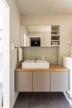 【EcoDecoスタッフ岡野の自邸リノベーション】洗面台は浮かせることで床の奥行きが見え、広く感じられる。グリーンのタイル貼りは岡野が自ら行った。 #洗面室 #洗面台 #タイル #ニッタイ工業 #Pタイル #EcoDeco #エコデコ #インテリア #リノベーション #renovation #東京 #福岡 #福岡リノベーション #福岡設計事務所 Double Vanity, Bathroom, House, Rooms, Washroom, Bedrooms, Home, Full Bath, Bath
