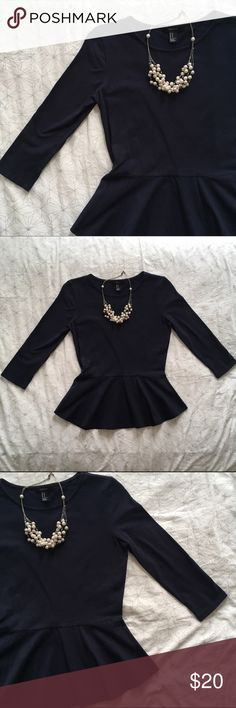 Sleek Navy Peplum Top Love this deep Navy Peplum top for work or play - so flattering!! Never worn, beautifully fitted, and of a thick and forgiving material (95% cotton 5% spandex) Forever 21 Tops Blouses