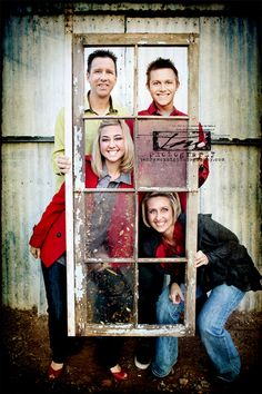 Use an old window for family photos. I love this idea!!