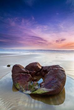 Moeraki Boulders, New Zealand The Moeraki Boulders appeared prehistoric bathed under the early morning light. This was a single frame, taken with a hard edge GND filter to brighten the foreground. Tasmania, Beautiful World, Beautiful Places, The Places Youll Go, Places To Visit, Moeraki Boulders, New Zealand Travel, South Island, Australia Travel