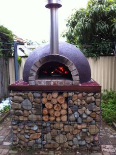 Gabion DIY Woodfire Oven: Love the blend of gabian rocks with the wood storage area. Super cool.