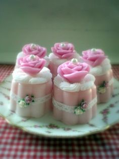 Pink rose soaps - I could probably make these with tin petit fours molds, layers of pink & white M&P soap, a dollop of white whipped soap frosting and a molded M&P rose and pearl on top