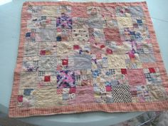 """18"""" by 20"""" . squares are approximately 2 ¼"""" with 9 ¾"""" tiny pieces.  looks to be machine pieced but all quilting is by hand.                      There is a 1"""" orange gingham border"""