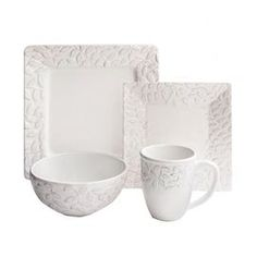 "Offering charming appeal for your dining room table, this lovely earthenware dinnerware set features raised scrolling details.    Product: 4 Dinner plates4 Salad plates4 Bowls4 MugsConstruction Material: Earthenware Color: WhiteFeatures: 14 Ounce capacity mugsDimensions: Dinner Plate: 10.75"" H x 10.75"" WSalad Plate: 8"" H x 8"" WBowls: 6.5"" Diameter"