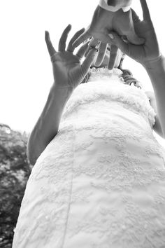 photo by destination wedding photographer vinicius matos black and white photo of bride putting ring on groom