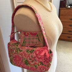 Vera Bradley set Pretty bag and ID holder, used a few times. Normal wear and tear. Vera Bradley Bags