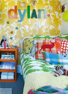 Must love pattern !   Bright, bold, boys room. Wallpaper is Florence Broadhurst 'Cockatoos'.