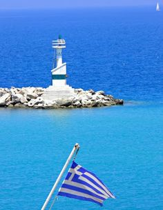 A lighthouse in Zakynthos and the Greek flag