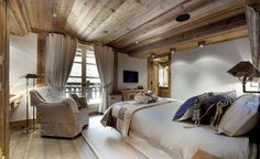 architecture-brown-blanket-on-white-bed-with-black-and-white-pillows-in-front-of-white-sofa-in-bedroom-corner-enticing-glamorous-wooden-chalet-interior-design-in-courchevel