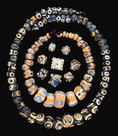 A COLLECTION OF MEDITERRANEAN GLASS EYE BEADS -  PHOENICIAN OR CARTHAGINIAN, CIRCA 6TH-2ND CENTURY B.C.