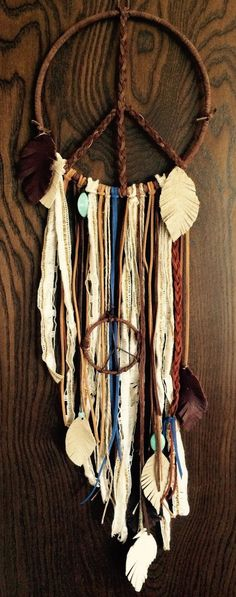 Leather Peace Sign Dream Catcher. The peace sign design is a big point for this one. Big braided peace sign for the hoop and a mini one for dropping down decoration, DIY leather feathers, shabby chic lacy ribbons...