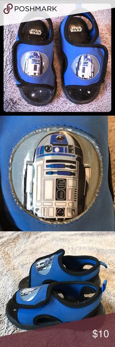Star Wars R2D2 Velcro Sandals Adorable R2D2 sandals for your little one! Velcro makes them easy to put on and take off. One small tear in upper trim (shown in pictures). Perfect for your little Jedi💕 Star Wars Shoes Sandals & Flip Flops