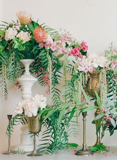 Vintage glassware filled with pink bougainvillea, pink pepperberry, jasmine vine, pink garden roses, bay laurel, and Queen Anne's lace will be sprinkled on the round tables.