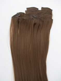 Synthetic hair extension ... Mmmmm should I go brown!