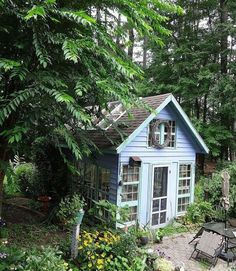 Don't throw anything out ever again—instead, create the perfect gardening shed with it, like this greenhouse constructed from old windows. Okay, so this might not work with every old thing you have lying around, but just imagine turning trash into a treasured gardening space with its own outdoor patio.   - CountryLiving.com