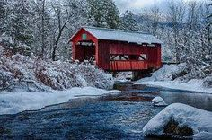 Quaint covered bridge in the snow