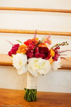 white with red and orange bouquet http://www.weddingchicks.com/2014/02/10/fall-wedding-at-historic-fort-reno-and-post-chapel/