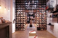 shoes flagship store in Bucharest by Glmashops Retail Store Design, Bucharest, Shoe Shop, Visual Merchandising, Showroom, Photo Wall, Basket, Boutique, Interior Design