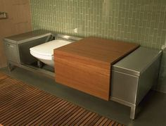 """Bench-toilet."" A toilet that hides under a sliding door to become a bench. Good for a minimalist bathroom (Japanese-style?)."