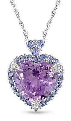 - Alluring necklace features a bright purple amethyst heart set amid frosty blue tanzanites Jewelry shimmers in white gold Heart pendant necklace with icy diamond accents is a beautiful gift for someone special Purple Jewelry, Bling Jewelry, Jewelry Accessories, Silver Jewelry, Purple Necklace, Amethyst Jewelry, Rhinestone Necklace, Turquoise Earrings, Fashion Accessories