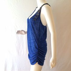 La Rok Tank Top or Cover Up Royal blue stretchy cover-up, 65% polyester, 35% rayon. With gunmetal and silver acrylic bling sewn on straps which criss-cross in back. Fabric is a burnout mix of Royal blue with light blue. Never worn. Plastic tag still attached with no paper tag . Perfect as a cover up it tank top. La rok Tops Tank Tops