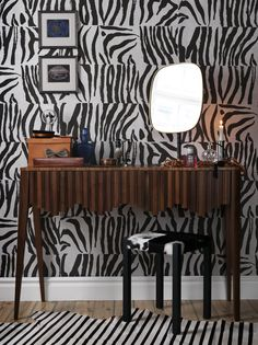 hand painted? zebra patterned wallpaper. i LOVE this console table, and the little glass element with a mustache on it. manly whimsy. // Photo: Karl Anderson/Sköna hem