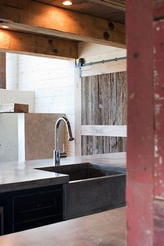 Kitchen - rustic barn door, concrete counters with built in farmer sink, painted shaker cabinets set off with the modern, polished chrome gooseneck faucet. Outdoor Kitchen Sink, Indoor Barn Doors, Barn Door In House, Eclectic Kitchen, Kitchen Rustic, Room Kitchen, Kitchen Ideas, Kitchen Design, Concrete Design