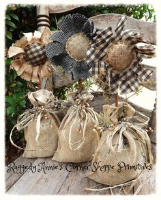 "raggedy ""fall blooms"" ~ set of 3. Prim flowers set on cinnamon sticks.. tucked in burlap sacks.. wrapped in raffia and pip berries. And softly scented with sweet annie.:)"