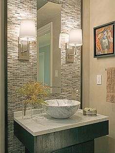 guest bath idea, always love the look of sconces in baths. Nice tile floor to ceiling effect with mirror.