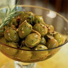 You can make and refrigerate this dish up to a week ahead; the flavors improve as the olives marinate. Use a mortar and pestle, meat mallet, or rolling pin to crush the coriander seeds and the rosemary.