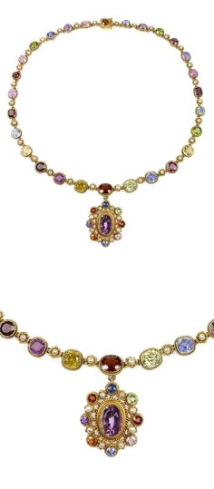 19th century vari-coloured gem and gold graduated pendant necklace, c.1880, the necklace with cushion cut stones including blue and coloured sapphires, zircon, garnet, pink topaz, demantoid garnet and peridot, each within a pinched collet with ropetwist wire border, pearl and gold bead and wirework flowerheads in between, the detachable pendant similarly set, centred by an oval facetted amethyst in vari-coloured gem border, all stones open set.