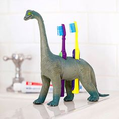 Dentalsaurus: Want to threaten cavities with extinction? Make your family's tooth-care regimen more entertaining by stowing brushes in this clever holder. To create one, use a hollow plastic dino. Trace the circumference of each brush handle with a washable marker, then use a craft knife to cut holes (adults only).