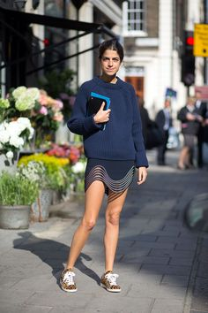 Really, Leandra can do no wrong.  Love the cheeky hemline on this navy look on a sunny London day during London Fashion Week SS16.