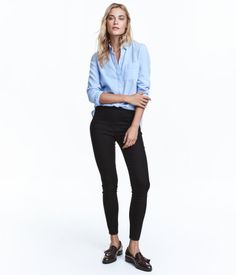 Black. Treggings in superstretch twill with a regular waist, a mock pocket at back, and visible side zip.