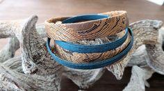 """Een wraparmband met een trendy barok plat koord in de kleur donkerblauw-bruin 10 mm en zijden plat scuba bleu koord van 5 mm.  Koperen normale sluiting met een label hartje """"made with love"""" en een label """"handmade""""  € 7,50"""