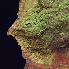 Credit: U.S. Geological Survey Earth Selfie Can you see the eye, hooked nose and mouth in this satellite image of Morocco? Seeing faces (or other images) in random things is called pareidolia. This Earth selfie was captured on Jan. 26, 2015 by Landsat 8. The face is looking over the waters just off Morocco's coast, with the city of Agadir underneath the chin. The irrigated farms of the Souss Valley are colored red.