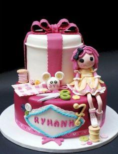 Likes the bow and ribbon making it a present  Lalaloopsy cake