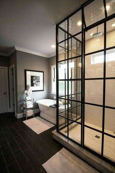 Love the shower's glass doors.