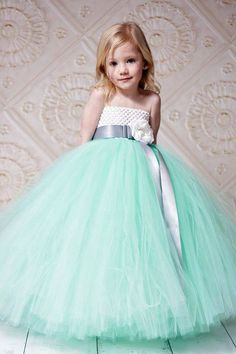 Adorable flower girl in mint green tulle