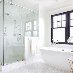 Oval Freestanding Bathtub Under Glossy Black Frame Window Big Bathtub, Big Tub, Luxury Bathtub, Freestanding Bathtub, Bath Under Window, Simple Bathroom, Bathroom Tubs, Concrete Bathtub