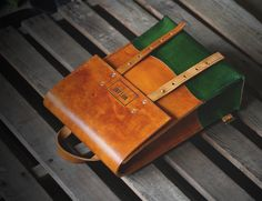 Man I generally don't like color on leather, but this green and saddle tan look great! Mifland : A Leather Goods Company
